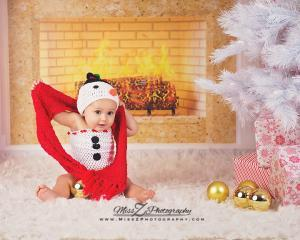 Baby dressed as a snowman