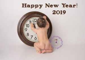 Naked bum baby with big clock about to strike midnight on New Years 2019